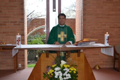 Fr. Luis at the altar
